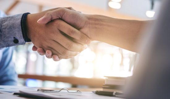Image of two hands in a handshake