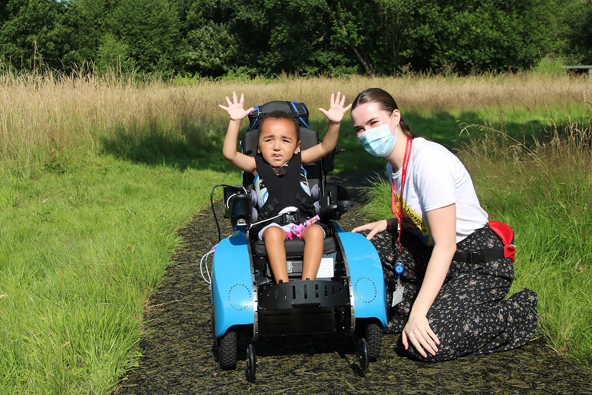 Four-year-old Rocco with Kelsey McDermott, a Specialist Carer at Noah's Ark Children's Hospice